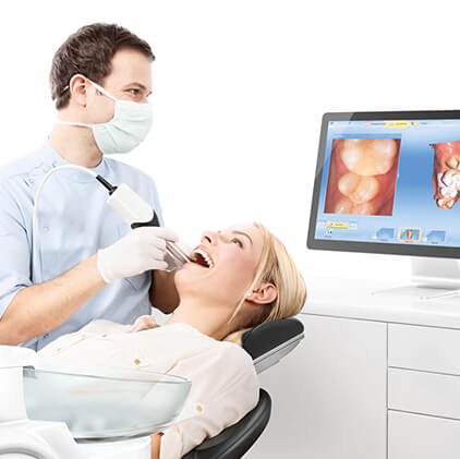 dentist looking at patients smile