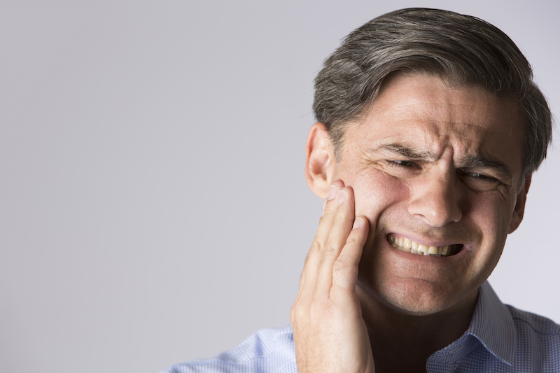 photo of a man with jaw pain
