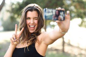 portrait of woman taking selfie