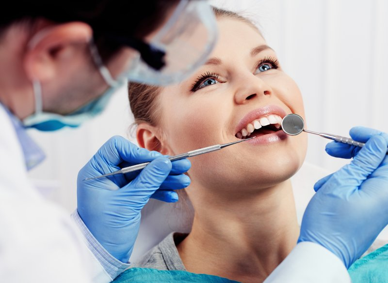 a woman receiving a dental cleaning