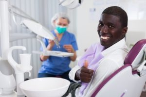 man smiling dental chair
