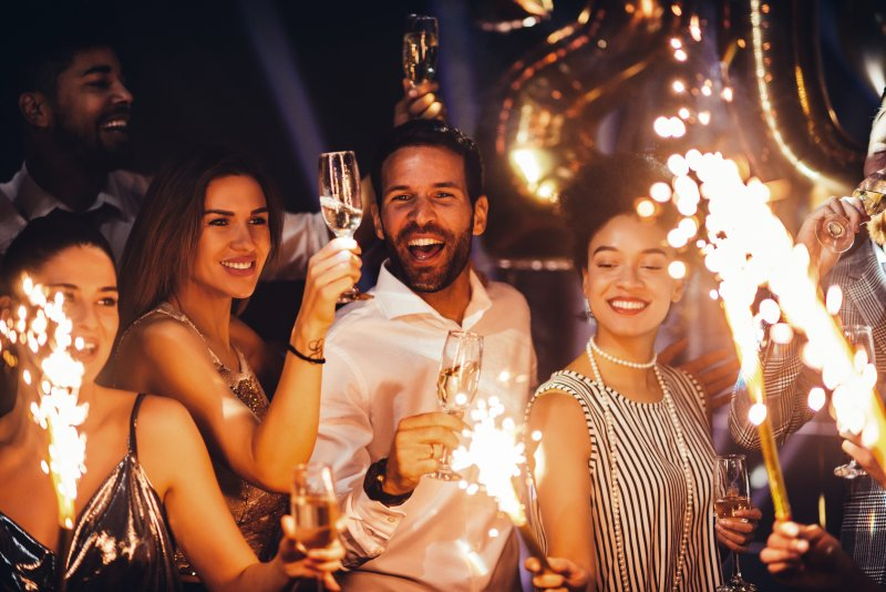 A group of people celebrating their new year's resolutions.